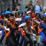 Para polisi cilik binaan Polres Batu saat unjuk kemampuan baris-berbaris usai upacara bendera HUT ke 17 Kota Batu di halaman Balai Kota Among Tani. (Foto: Nurlayla Ratri/MalangTIMES)