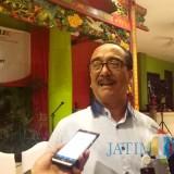 Kepala OJK Malang Widodo saat ditemui awak media. (Foto: Nurlayla Ratri/MalangTIMES)