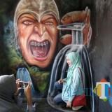 Wisatawan tampak berfoto di Kampung Tridi Kesatrian. (Foto: Nurlayla Ratri/ MalangTIMES)