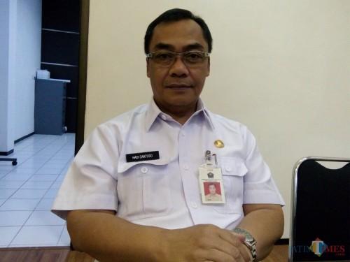 Kepala Dinas Pekerjaan Umum dan Penataan Ruang (PUPR) Kota Malang Hadi Santoso saat memberikan konfirmasi terkait jalanan rusak di Kota Malang. (Pipit Anggraeni/MalangTIMES)