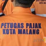 Ilustrasi, petugas pajak BP2D Kota Malang saat akan melaksanakan tugas lapangan. (Foto: Nurlayla Ratri/MalangTIMES)