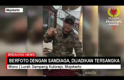 Suhartono Kepala Desa (Kades) Sampangagung, Mojokerto saat berpendapat terkait statusnya menjadi tersangka lantaran berfoto bersama Calon Wakil Presiden (Cawapres) nomor urut dua Sandiaga Uno (Foto : Screenshot youtube)