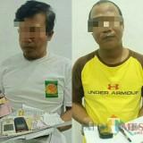 Kedua pelaku judi togel yang berhasil diamankan tim Reskrim Polsek Kota Banyuwangi.