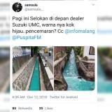 Tangkapan layar unggahan netizen terkait aliran air di saluran irigasi di Kota Malang yang berwarna hijau toska. (Foto: Twitter)