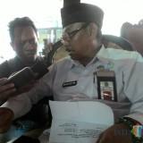 Kepala Dinsos Kabupaten Malang Nurhasyim membeberkan data angka kemiskinan dan bantuan pusat ke warga miskin Kabupaten Malang (Nana)