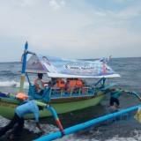 Salah satu perahu wisata di Pantai GWD yang di-branding dengan gambar Caleg