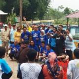 Pelatih dan official Tirta Meru saat peringatan ulang tahun perkumpulan di kolam Hutan Bambu. (Foto: Pawitra/JatimTIMES)