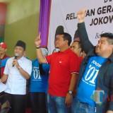 Agus Setiawan (berjaket hitam) bersama Bupati dan Ketua DPRD Lumajang (Foto : Moch. R. Abdul Fatah / Jatim TIMES)
