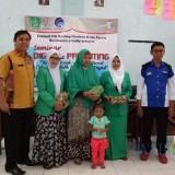 Syahrial Fary, ST, M Si (Kanan) dan Ismail MPd, Praktisi Digital Parenting (Kiri) foto bersama ketua panitia