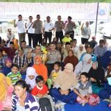 Suasana bakti sosial kesehatan dan sunatan masal di Desa Ketowan yang diselenggarakan Polda Jatim (Foto: Heru Hartanto/Situbondo TIMES)