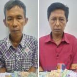 Pengecer Bambang Sutedjo (kiri)  dan bandar togel Nanang Fitrianto kini ngandang di rutan Mapolsek Kota Banyuwangi.