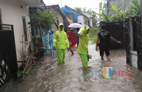 Salah satu kejadian banjir di Desa Torongrejo, Kecamatan Junrejo terjadi pukul 15.00 (Foto: Pudalops PB BPBD Kota Batu for BatuTIMES)