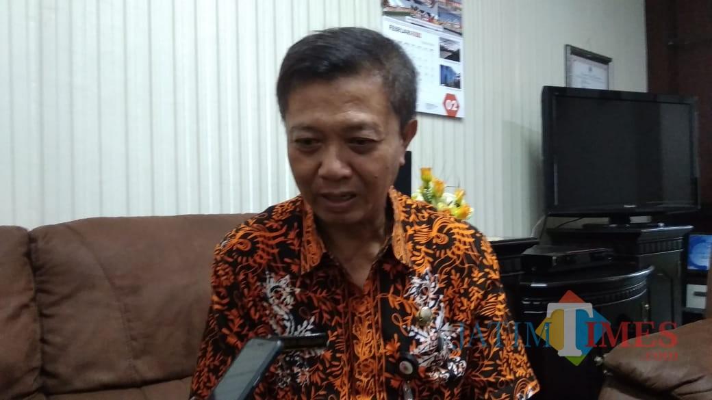 Kepala BKD Pemkab Jember Ruslan Abdul Gani saat dikonfirmasi. (foto : Moh. Ali Makrus / Jatim TIMES)