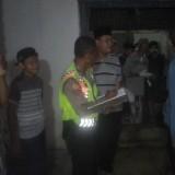 Pihak Kepolisian ketika melakukan olah TKP. (Foto: Ist)