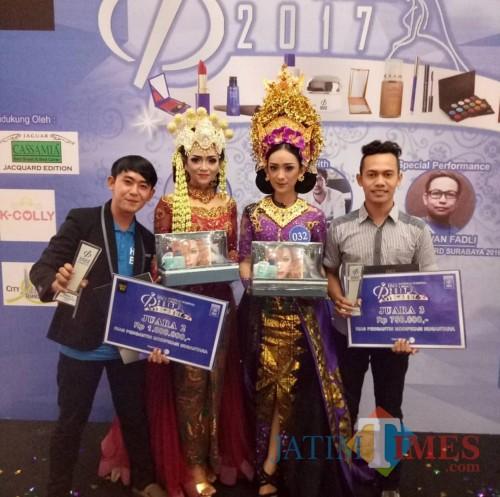 Richo Adriansyah (kiri) saat meraih juara perlombaan tata rias dan kontes busana (Foto : Richo Adriansyah for MalangTIMES)