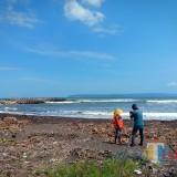ilustrasi pantai Pancer lokasi korban terseret ombak
