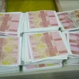 Ilustrasi uang palsu (bisnis.com)