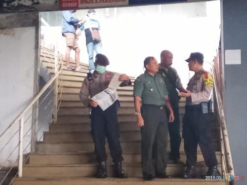 Situasi Pasar Besar saat petugas melakukan olah TKP pasca kejadian mutilasi (Anggara Sudiongko/MalangTIMES)