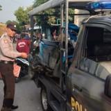Petugas dari kepolisian ketika melakukan olah TKP. (Foto: Ist)