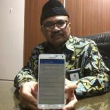 Kepala Bapenda Kabupaten Malang, Dr Purnadi saat memamerkan aplikasi pembayaran pajak, Kabupaten Malang (Foto : Dokumen MalangTIMES)