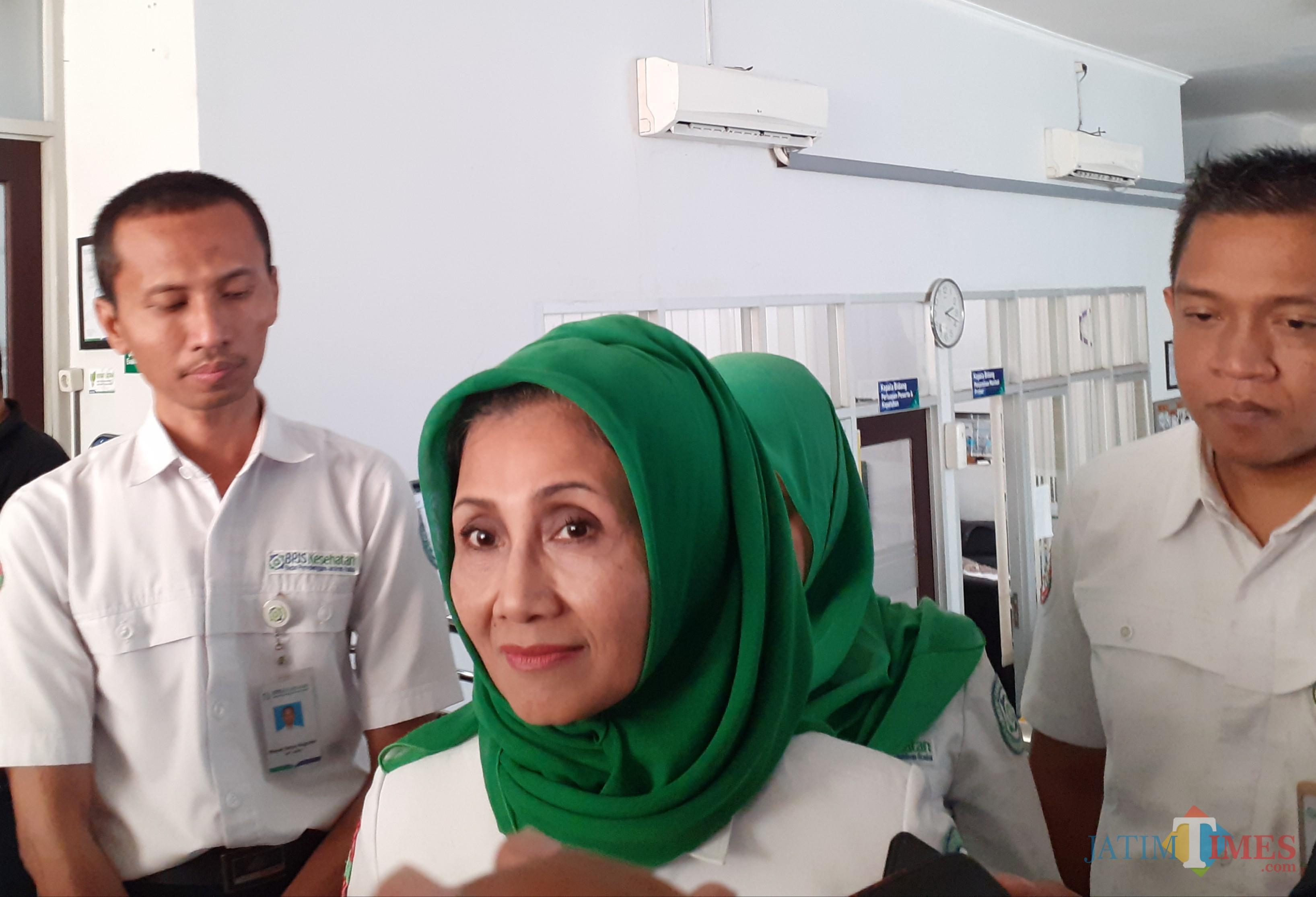 Kepala BPJS Cabang Malang, Hendry Wahjuni (berjilbab) (foto: Arifina Cahyanti Firdausi/MalangTIMES)