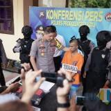 Niman pelaku penganiayaan saat kasusnya di rilis (Agus Salam/Jatim TIMES)