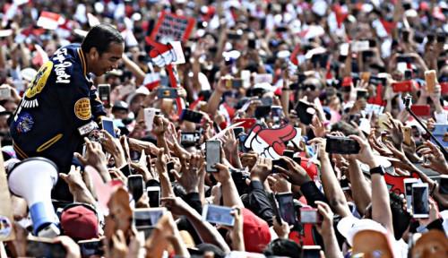 Kampanye Jokowi dalam pilpres yang mampu menumbuhkan militansi di segmen wong cilik melalui kartu sakti (Ist)