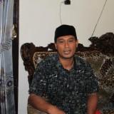Rahmat atau Ponco Sura saat di rumahnya (Agus Salam/Jatim TIMES)