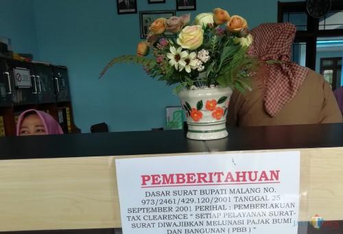 Kebijakan tax clearence diuji coba desa untuk percepatan pelunasan PBB-P2. (Nana)