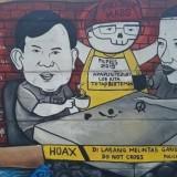 Grafiti di Jakarta yang menyiratkan harapan besar kedua tokoh bangsa kembali bersatu (Ist)