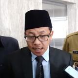 Wali Kotw Malang Sutiaji (tengah) didampingi Wakil Wali Kota Malanh Sofyan Edi Jarwoko (kiri) dan Sekretaris Daerah Kota Malang Wasto (kanan).