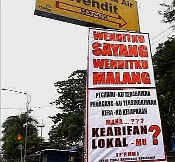 Banner protes masyarakat Mangliawan atas rencana pengelolaan wisata Wendit yang dipihak ketigakan (Ist)