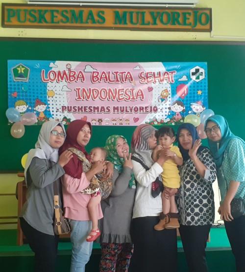 Suasana antusiasme ibu dan anak mengikuti Lomba Balita Sehat Indonesia di Puskesmas Mulyorejo (Arifina Cahyanti Firdausi/MalangTIMES)