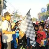 Situasi pelepasan gerak jalan sehat yang menggambil start dan finis di depan Pendopo Kabupaten Jalan Kartini Situbondo. (Foto Heru Hartanto/Situbondo TIMES)