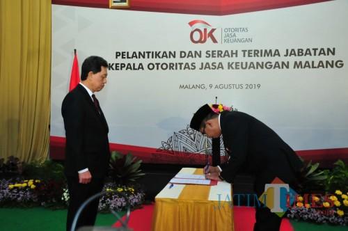 Kegiatan pelantikan dan serah terima jabatan Kepala OJK Malang . (Foto: Nurlayla Ratri/MalangTIMES)