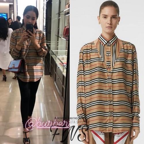 Nagita Slavina saat berswafoto menggunakan�kemeja Burberry Cut Out Detail Icon Stripe Silk Oversized Shirt. (Foto: istimewa)