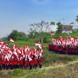 540 Bendera Berkibar di Atas Kali Lanang Kota Batu
