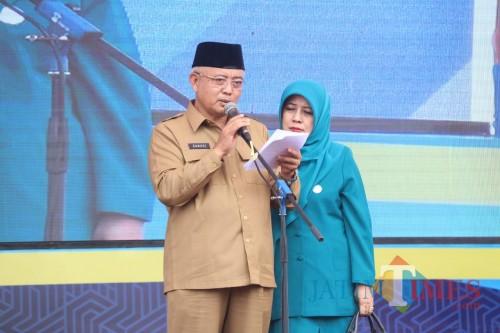 Plt Bupati Malang Sanusi besera istri Anis Zaida saat membuka acara Harganas ke-XXVI di Desa Bayem, Kecamatan Kasembon (Humas Pemkab Malang for MalangTIMES)