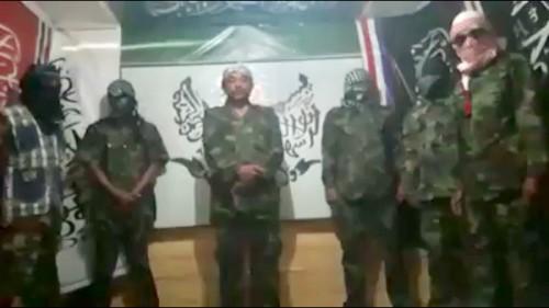 Video dengan enam orang pria berdiri rapi di sebuah ruangan mengatas namakan PKAD/AM .