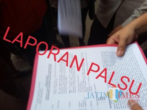 Ilustrasi laporan palsu (Anggara Sudiongko/MalangTIMES)
