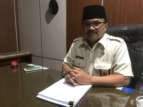 Kepala Bapenda Kabupaten Malang, Dr Purnadi saat ditemui terkait pembahasan pemasukan pajak Minerba (Foto : Ashaq Lupito / MalangTIMES)