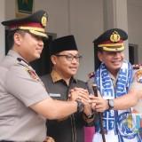 Apel Tiga Pilar Sambut Kapolresta Baru, Bendera Raksasa Diarak ke Balai Kota Malang