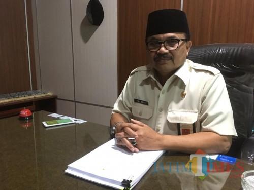 Kepala Bapenda Kabupaten Malang, Dr Purnadi saat menjelaskan potensi pajak penerangan jalan yang ada di wilayahnya (Foto : Ashaq Lupito / MalangTIMES)