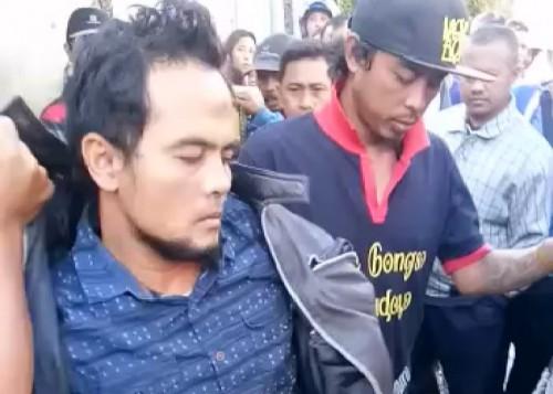 Pelaku saat diamankan petugas usat dihadiahi timah panas (ist)