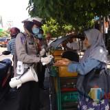 Cegah Covid 19, Polres Malang Kota Edukasi Warga dengan Turun ke Pasar dan Pertokoan