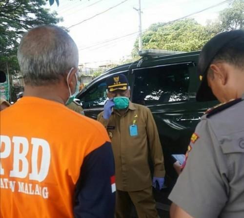 Bupati Malang HM. Sanusi saat menjelaskan perihal penyebab warganya terpapar corona. (Foto : Istimewa)