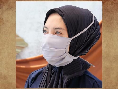 Ilustrasi penggunaan masker kain. (Foto: Istimewa)