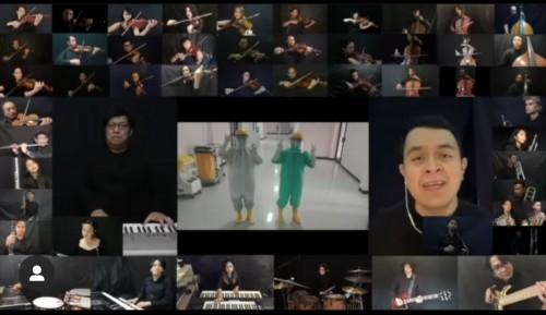 """Cuplikan konser virtual Erwin Gutawa dan Tulus bertajuk """"Konser Orkestra di Rumah"""" dengan 50 musisi. (Foto: video capture instagram @tulusm)"""