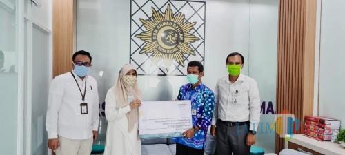Peduli Medis, Bank Mandiri Syariah Serahkan Bantuan APD dan Masker Senilai Rp 3,05 Miliar