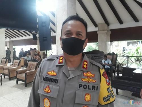 Kapolres Malang AKBP Hendri Umar saat menghadiri sosialisasi TFG (Tactical For Game) untuk persiapan PSBB Malang Raya di Pendopo Agung Malang, Kamis (14/5/2020). (Foto: Tubagus Achmad/MalangTimes)